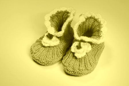 soft sell: wool woven childrens shoes on white background, closeup of photo