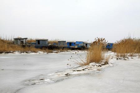 frozen river: frozen river and broken ships, closeup of photo