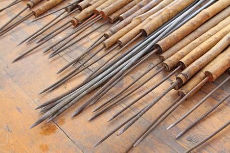 brazing: Wooden handle steel steel brazing, closeup of photo Stock Photo