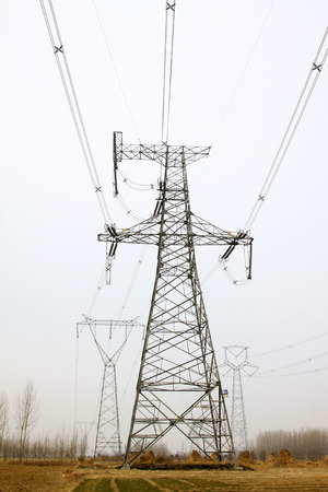 solid wire: Electrical towers and power lines, closeup of photo