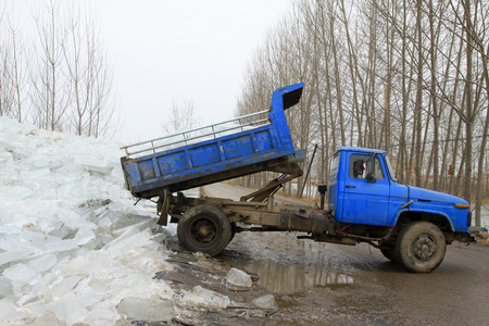 scenarios: Heavy truck transport ice in the winter, closeup of photo, china