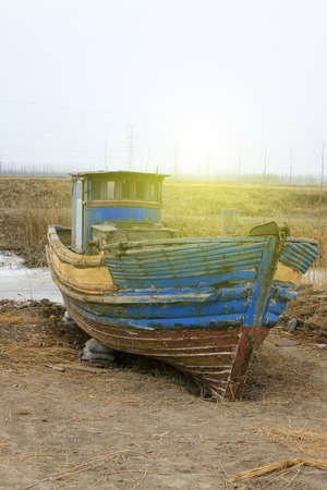dazzle: Broken boat on land, closeup of photo Stock Photo