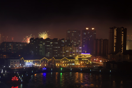 features: fireworks on New Years eve in the city, closeup of photo