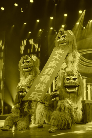 stage props: TANGSHAN - JANUARY 26: The traditional Chinese lion dance style on stage, January 26, 2014, tangshan, china. Editorial