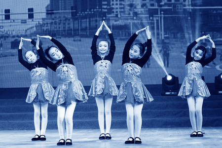 niños actuando: TANGSHAN - JANUARY 26: The childrens dance performance on the stage, January 26, 2014, tangshan, china.