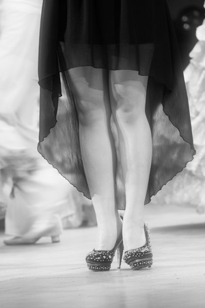beautiful ankles: female legs wearing high heeled shoes on the stage Stock Photo