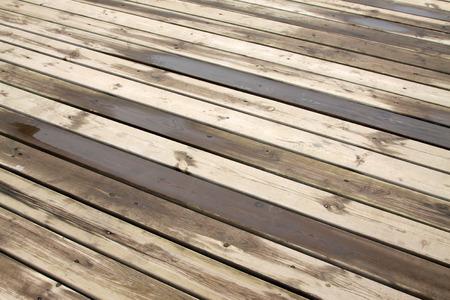 on wood floor: wet wood floor Stock Photo