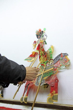 nonphysical: Chinese shadow play figures, closeup of photo