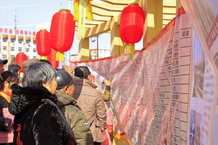 restore ancient ways: LUANNAN COUNTY - MARCH 5: On the Lantern Festival Day, people were guessing riddles in a park, March 5, 2015, luannan county, hebei province, China Editorial