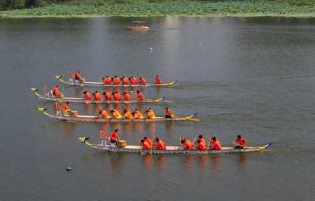 customs and celebrations: LUANNAN COUNTY - AUGUST 9: dragon boat race scene in the river on august 9, 2014, Luannan County, Hebei Province, China. Editorial