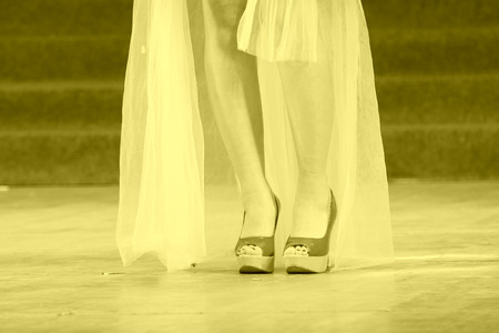 beautiful ankles: female legs wearing high heels on the stage Stock Photo
