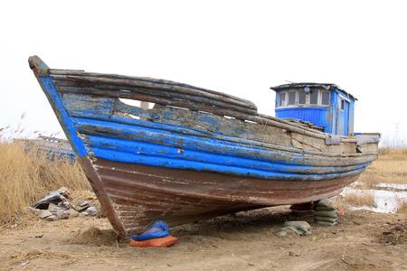 restore ancient ways: Broken boat on land, closeup of photo Stock Photo