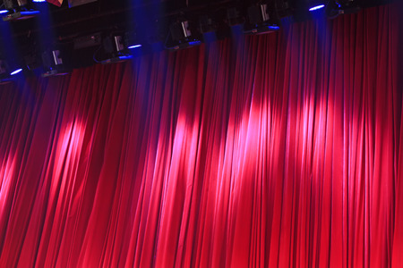 droplight: Red curtain and stage lights, closeup of photo Editorial