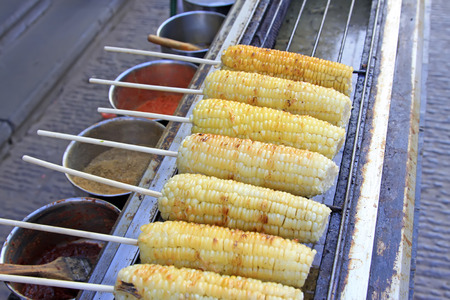 bunchy: Grilled corn in a restaurant, closeup of photo Stock Photo