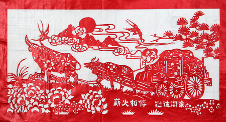 immaterial: TANGSHAN CITY - MARCH 16: Chinese paper-cut works on white background in a shop, on march 16, 2015, Tangshan City, Hebei Province, China Editorial