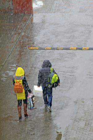 pedestrians: Pedestrians walking in snow and rain, closeup of photo