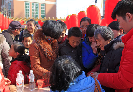 guessing: LUANNAN COUNTY - MARCH 5: On the Lantern Festival Day, people were guessing riddles in a park, March 5, 2015, luannan county, hebei province, China Editorial