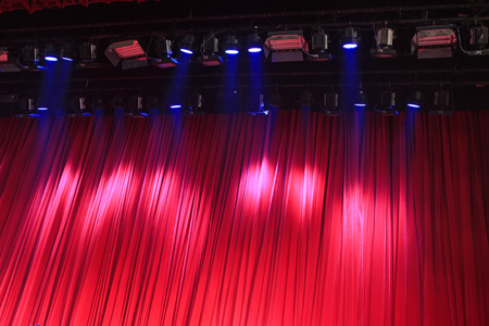 droplight: Red curtain and stage lights, closeup of photo Stock Photo
