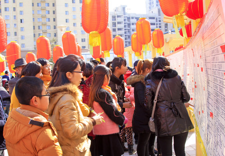 quizzes: LUANNAN COUNTY - MARCH 5: On the Lantern Festival Day, people were guessing riddles in a park, March 5, 2015, luannan county, hebei province, China Editorial