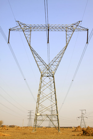 solid wire: Electric power tower under the blue sky, closeup of photo