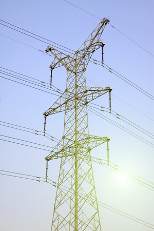 energia electrica: Electric power tower under the blue sky, closeup of photo