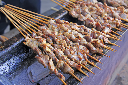 bunchy: Grilled Chicken gizzard in a restaurant, closeup of photo