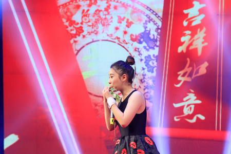 stage props: LUANNAN COUNTY- FEBRUARY 13: girl singing performance on stage, on February 13, 2015, Luannan, Hebei Province, china. Editorial