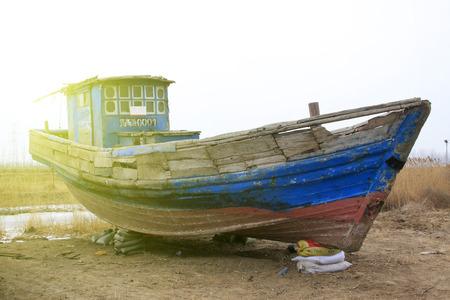 restore ancient ways: Broken boat on land, closeup of photo Editorial