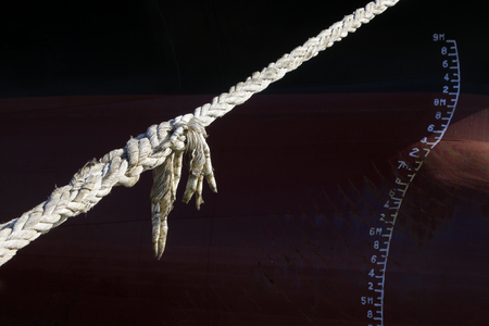 strong toughness: closeup of nylon rope tied to the column.