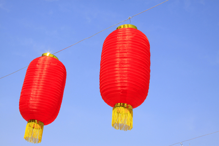 bunchy: Close up to two hanging red lanterns under the clear blue sky