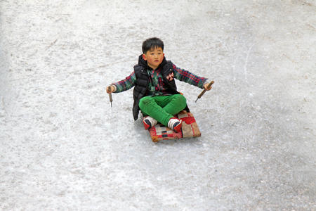 boy skating: LUAN COUNTY - JANUARY 10: A boy skating on the ice on January 10, 2015, Hebei Province, Luan County, China Editorial