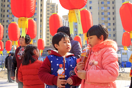 LUANNAN COUNTY - MARCH 5: On the Lantern Festival Day, people were guessing riddles in a park, March 5, 2015, luannan county, hebei province, China Editorial