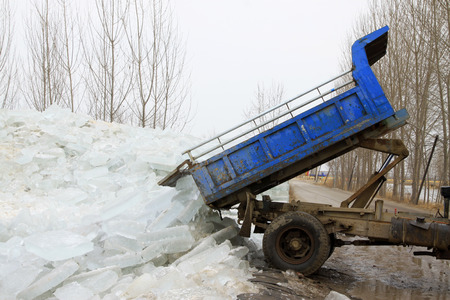 scenarios: Heavy truck transport ice in the winter, china.