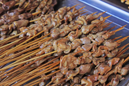 gizzard: Grilled Chicken gizzard in a restaurant, closeup of photo