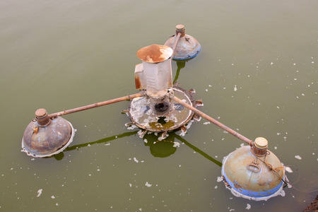 aerator: old aerator in the pond, closeup of photo Stock Photo