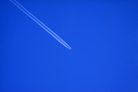 A jet plane in the blue sky background, closeup of photo Stock Photo