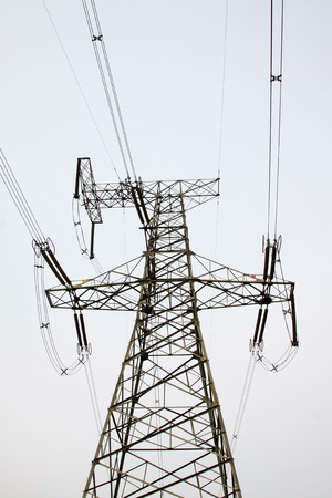 solid wire: Electricity tower in the sky, closeup of photo