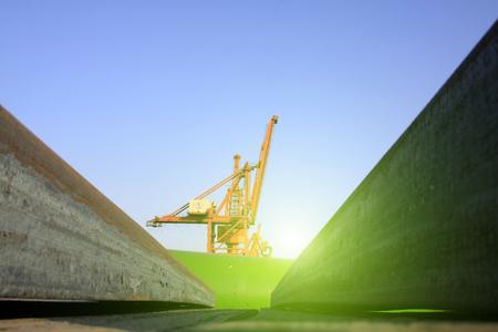 ingot: Portal crane and steel ingot, closeup of photo