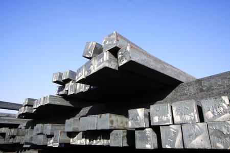 ingot: Steel ingot under the blue sky, closeup of photo Editorial
