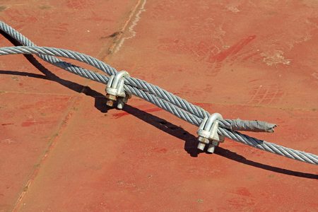 fastener: steel wire rope and fastener, closeup of photo Stock Photo