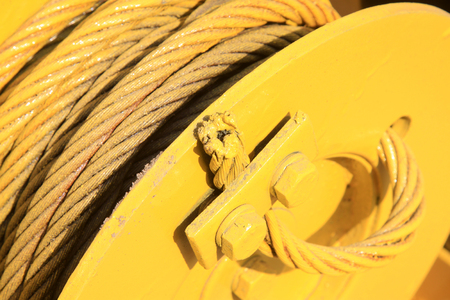 toughness: yellow steel wire rope, closeup of photo