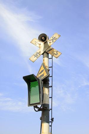 careful: careful train signal light, closeup of photo