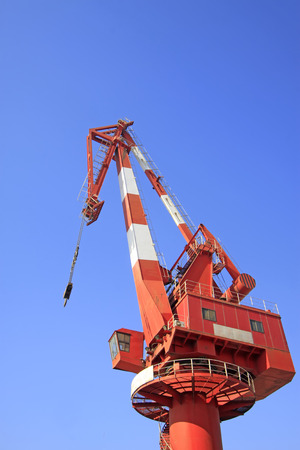 strong base: Crane under the blue sky background, closeup of photo