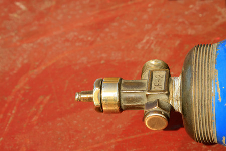put pressure: oxygen cylinder valve, closeup of photo Editorial