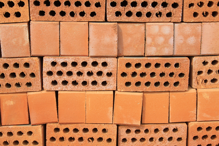 feature wall: red hollow brick, closeup of photo Stock Photo