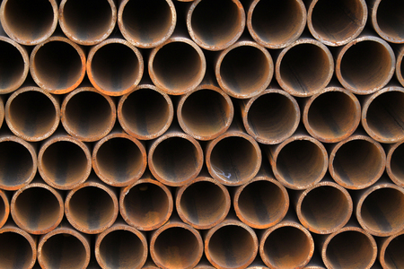 semifinished: Piles of steel pipe, closeup of photo