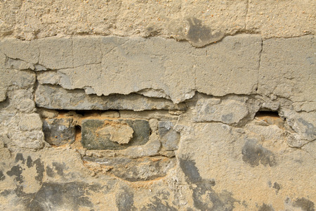 restore ancient ways: debris cement wall, closeup of photo Stock Photo