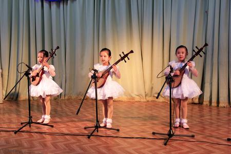 pipa: Sinuiju - March 28: Kindergarteners were performancing literature and art show, on March 28, 2015, sinuiju, north Korea.