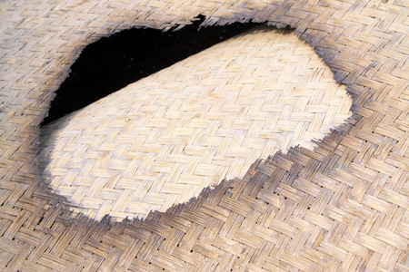 restore ancient ways: Burn a hole in the reed mat, closeup of photo