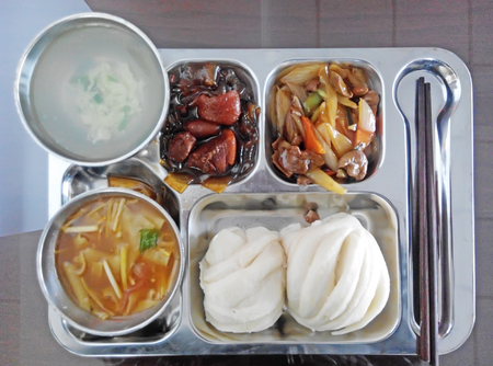 lunch tray: Lunch in the stainless steel tray, closeup of photo